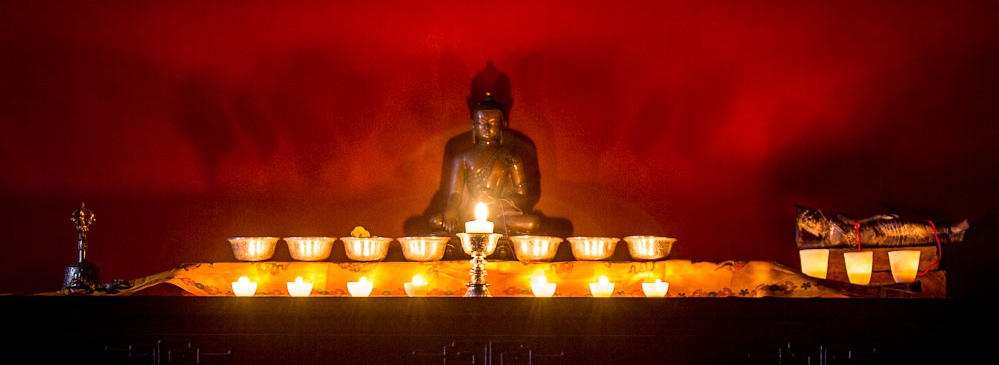 northern light beeswax candles on a buddhist altar